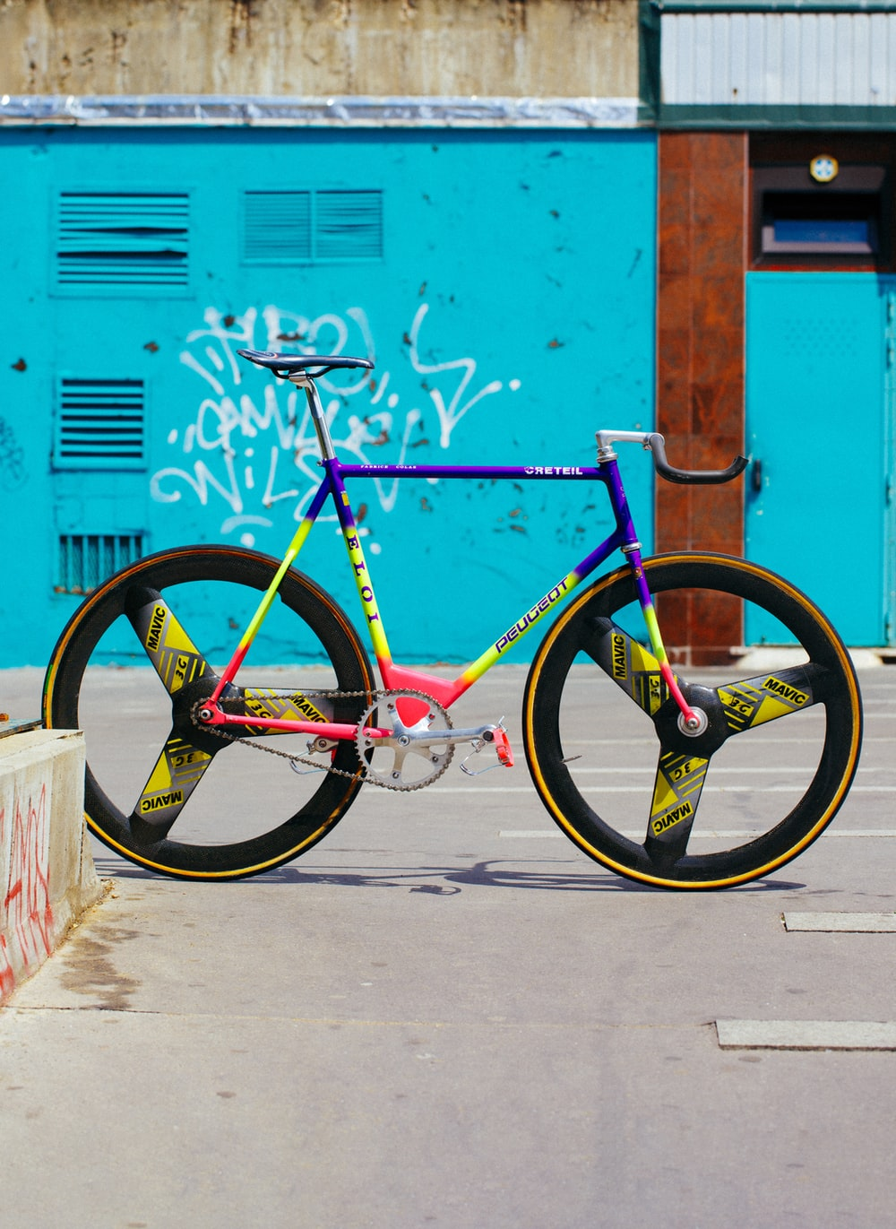 yellow, pink, and blue road bike