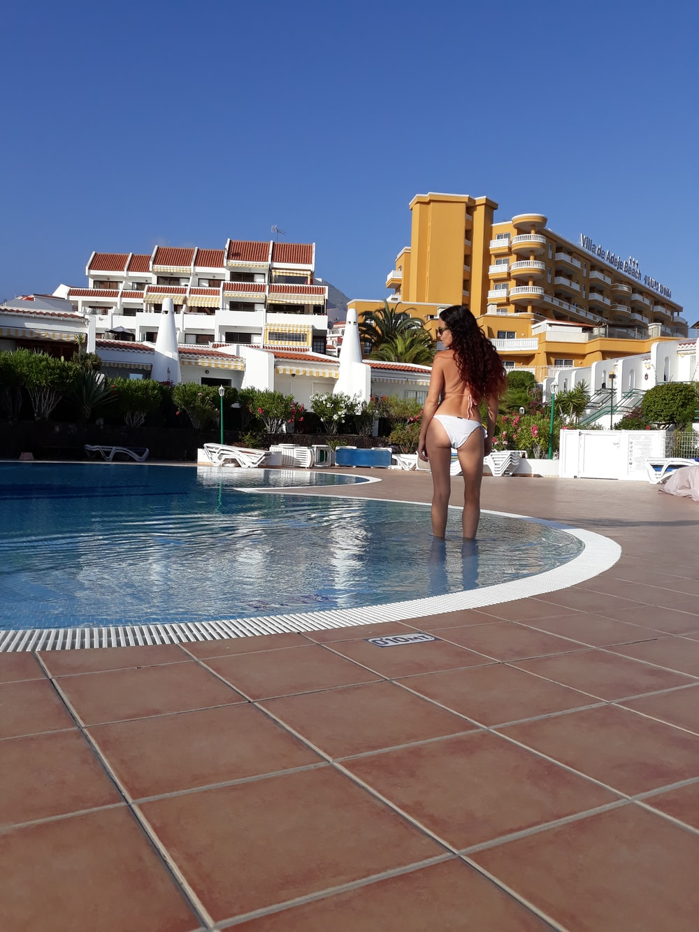 woman standing on water pool