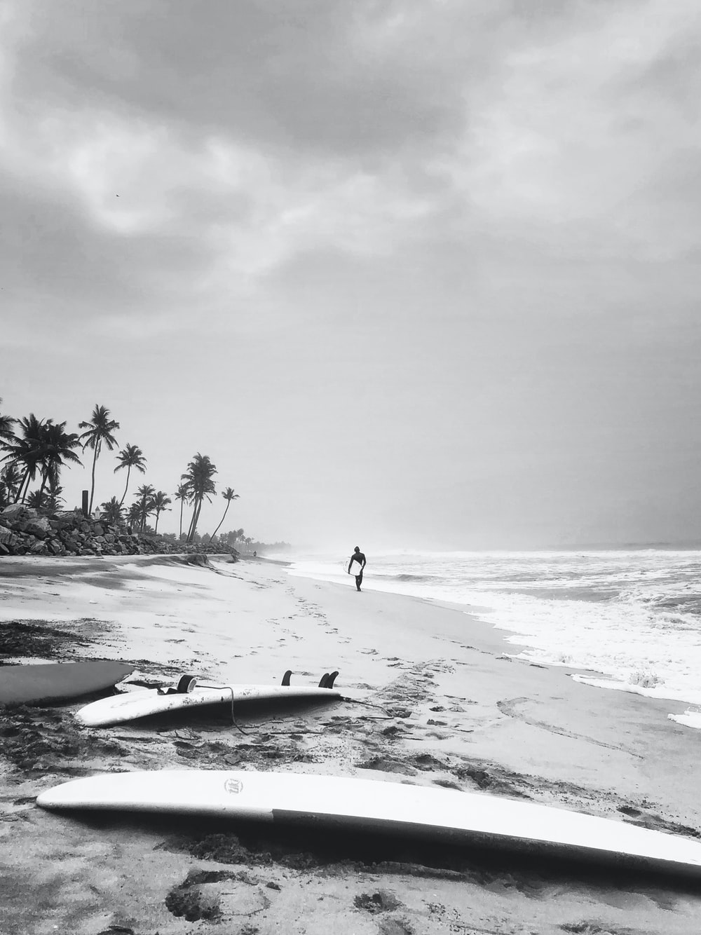 two surfboards on shore