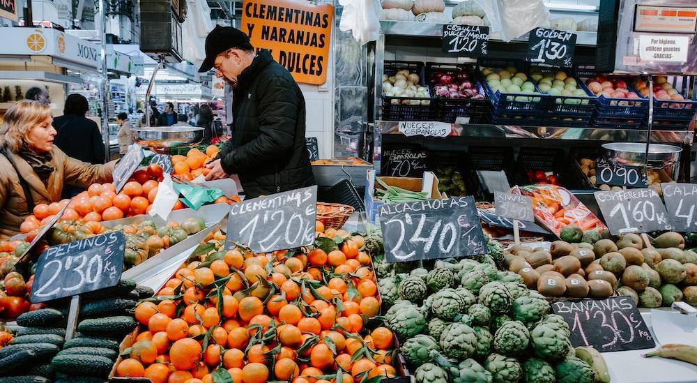 man standing near vegetables