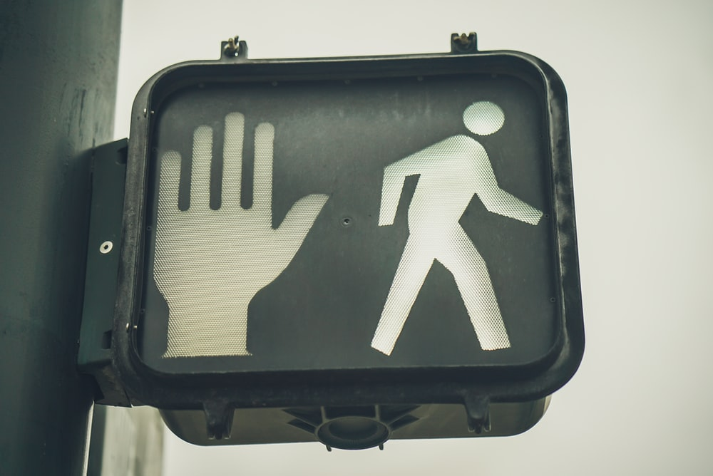 black go and stop pedestrian signage