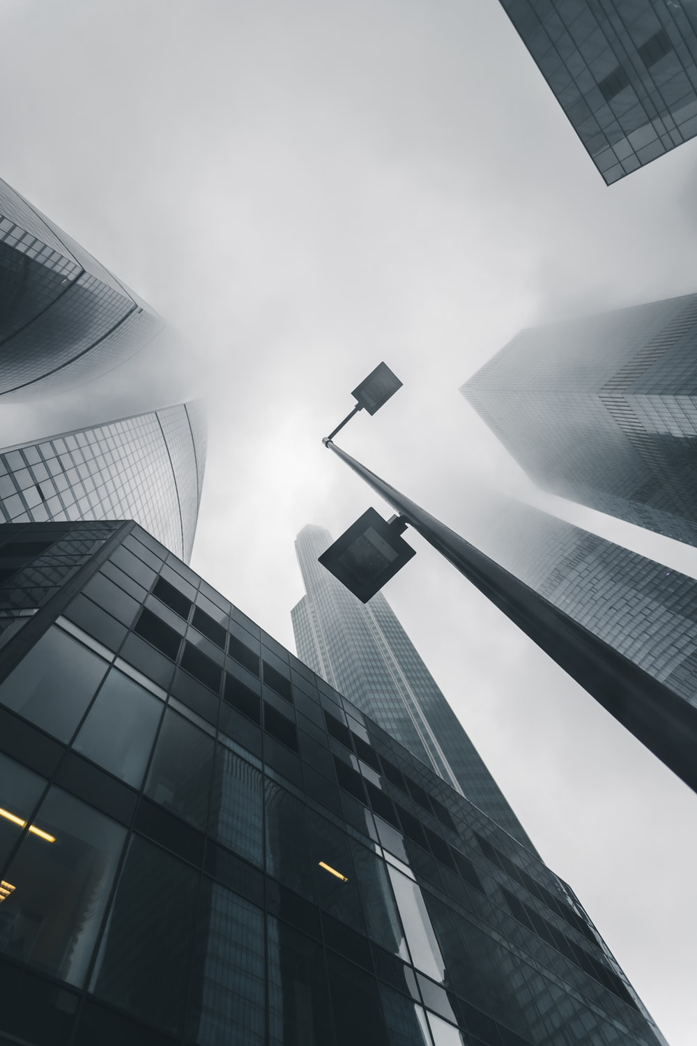low angle photography of black-and-gray buildings