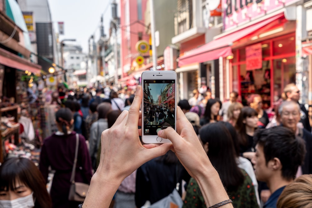 person taking a photo of people