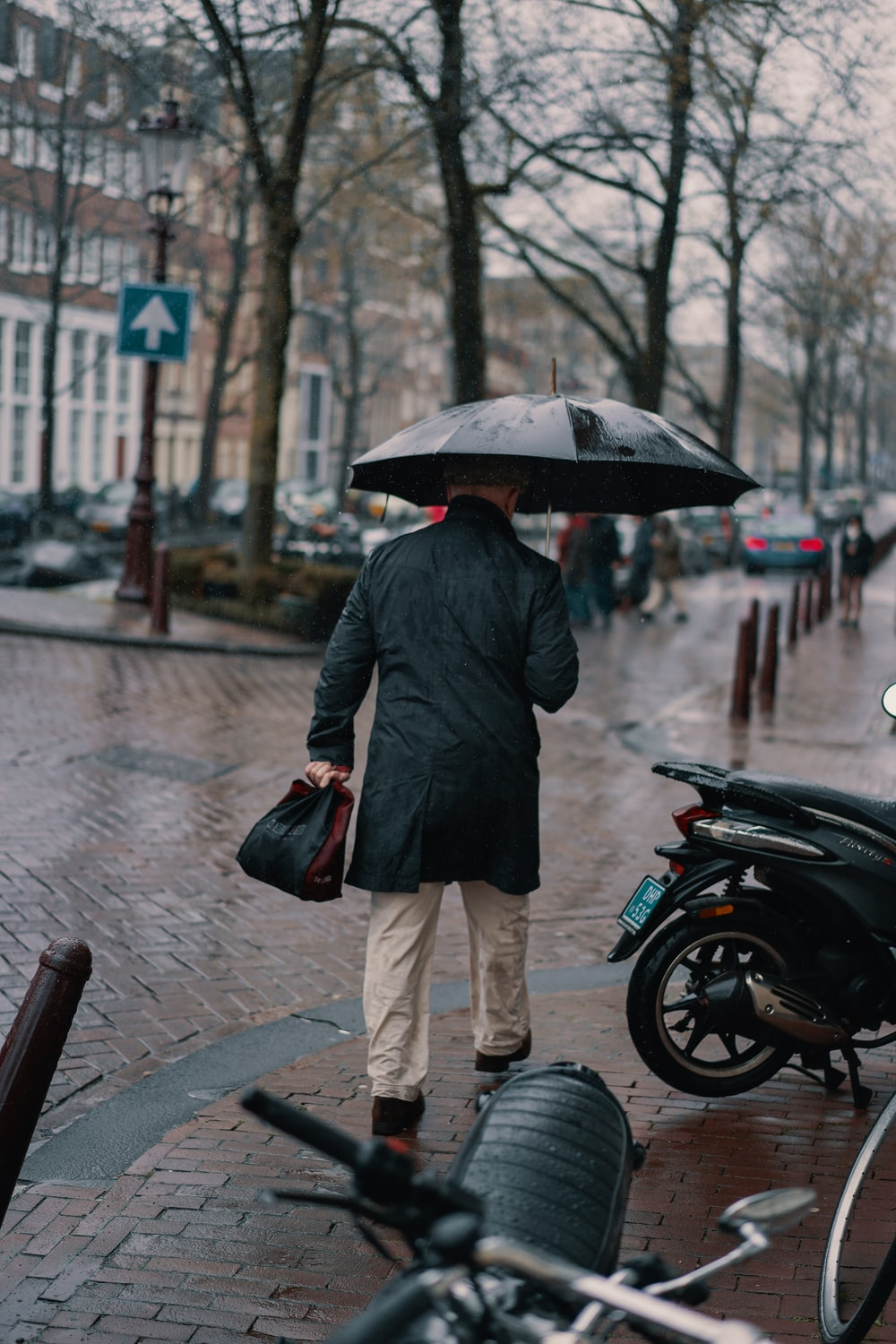 man holding black umbrella