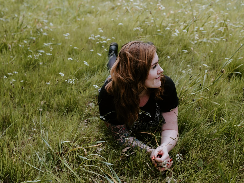 woman lying on grasses
