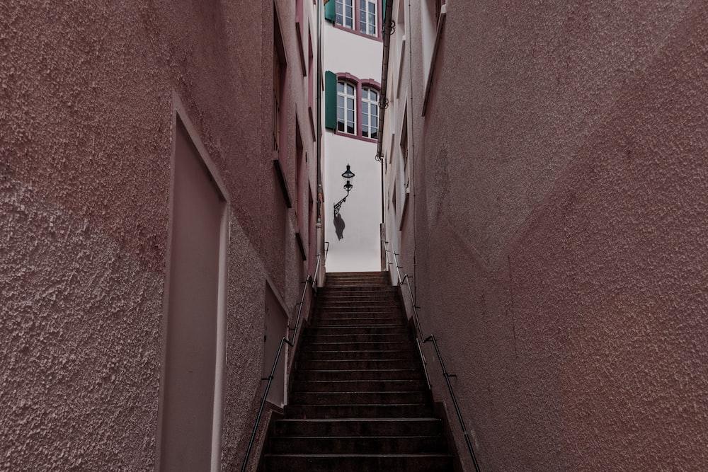 empty stair between concrete buildings