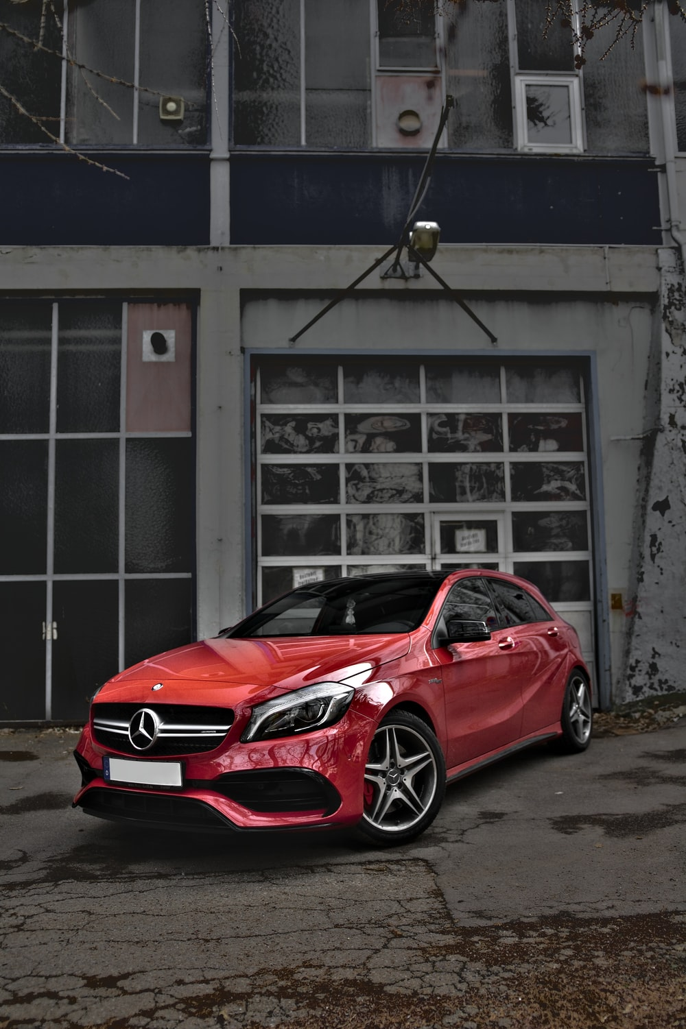 red Mercedes-Benz car on road