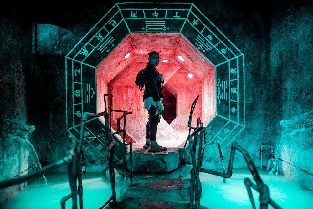 man standing inside tunnel