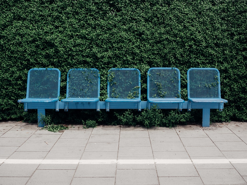 five seat blue metal bench