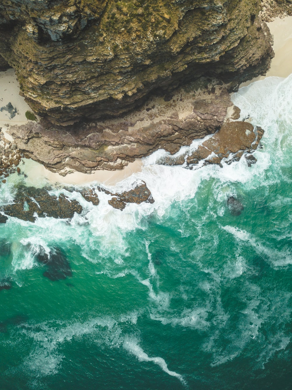 aerial photography of cliff near body of water