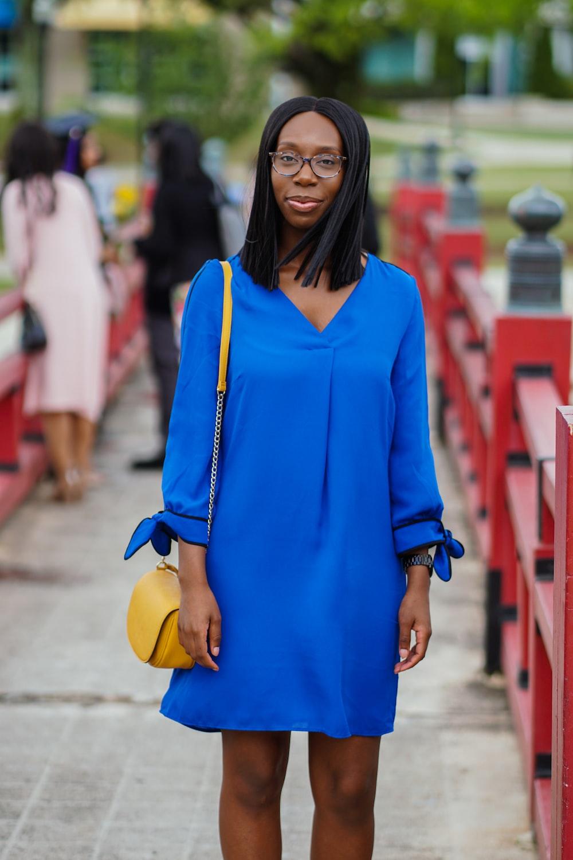 woman in blue long sleeved mini dress