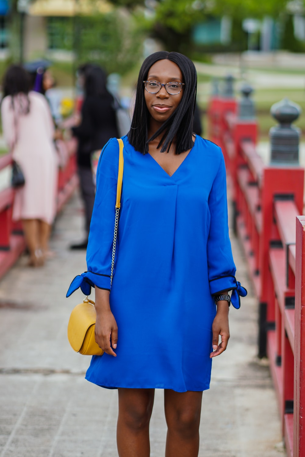woman in blue long sleeved mini dress