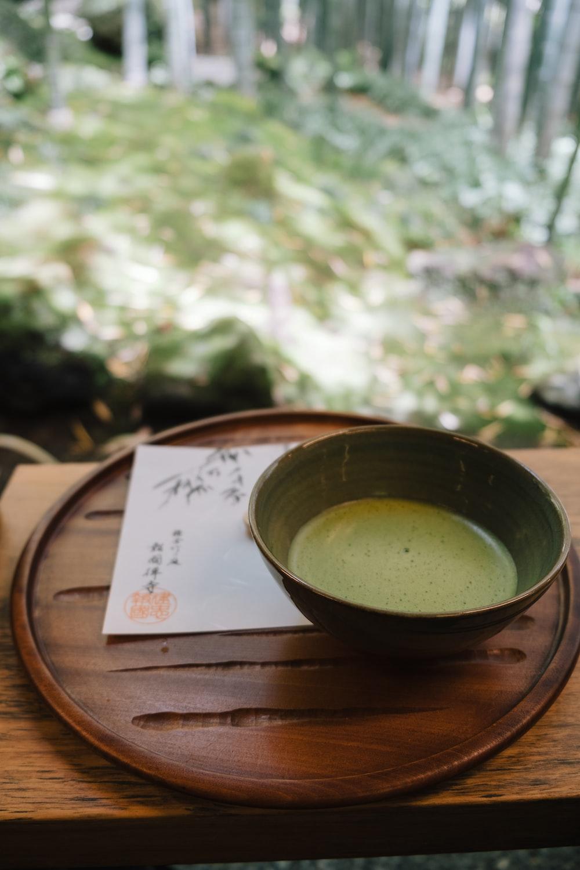 green tea on green ceramic teacup