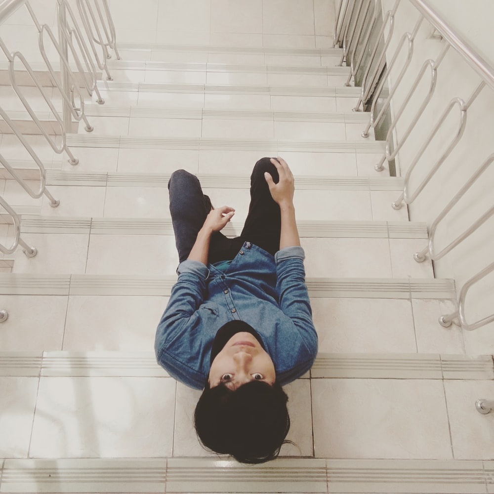 unknown person sitting on stair