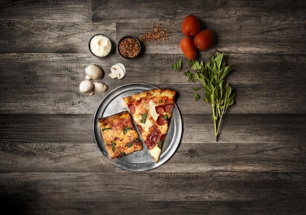 slice of pizza on dish