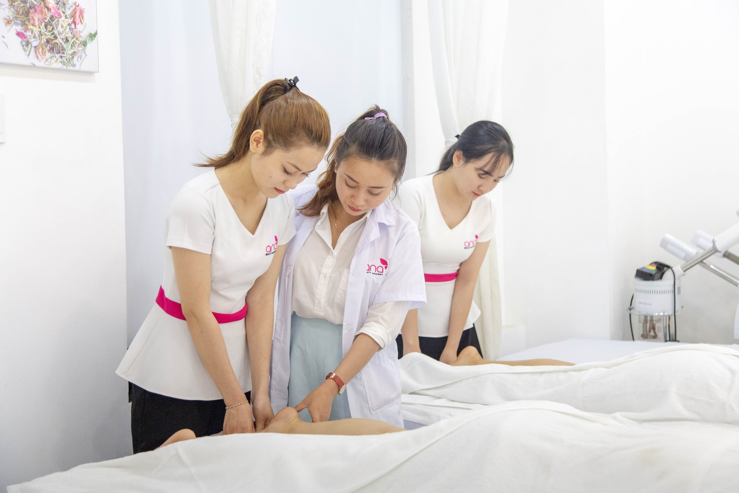 one woman assisting another woman in massaging
