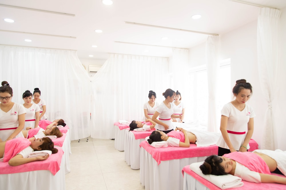 massage room with pink and white theme