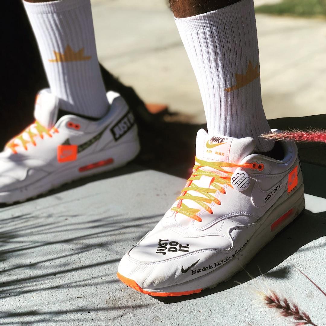Nike shoes with AmongstXYZ socks.