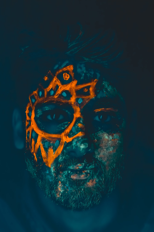 man with orange mask