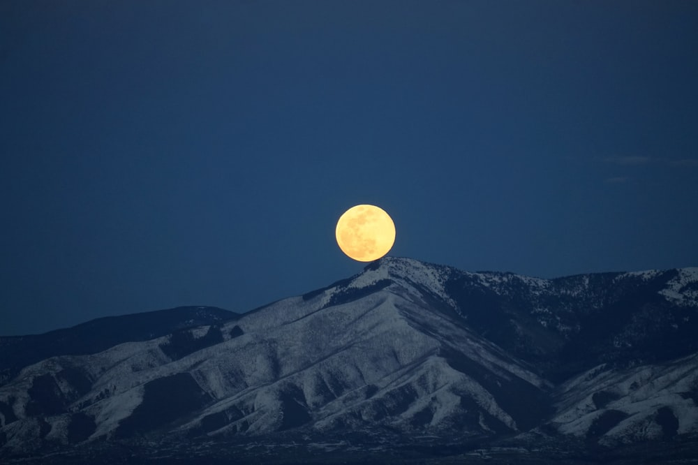 photo of moon and mountain