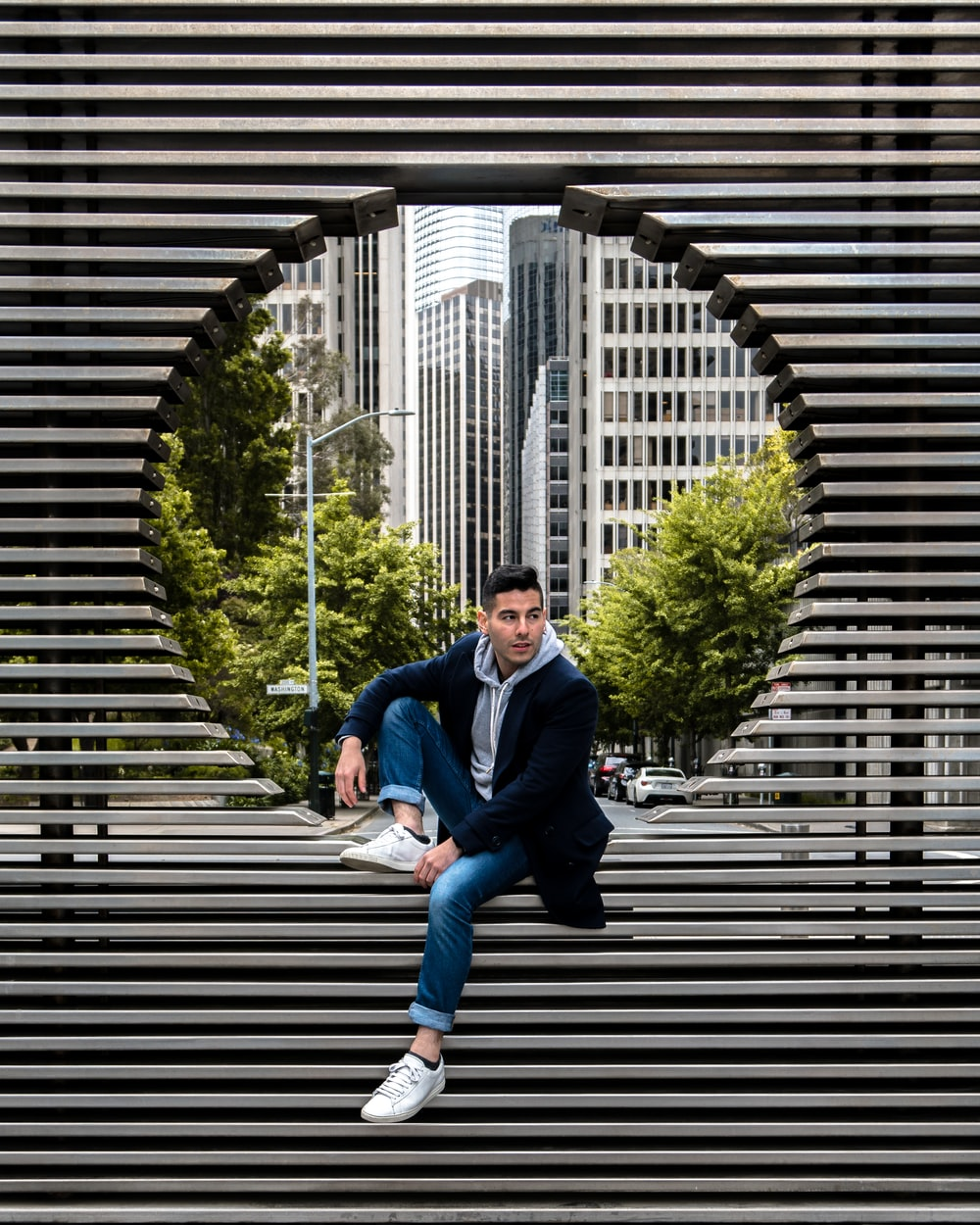 man sitting on structure