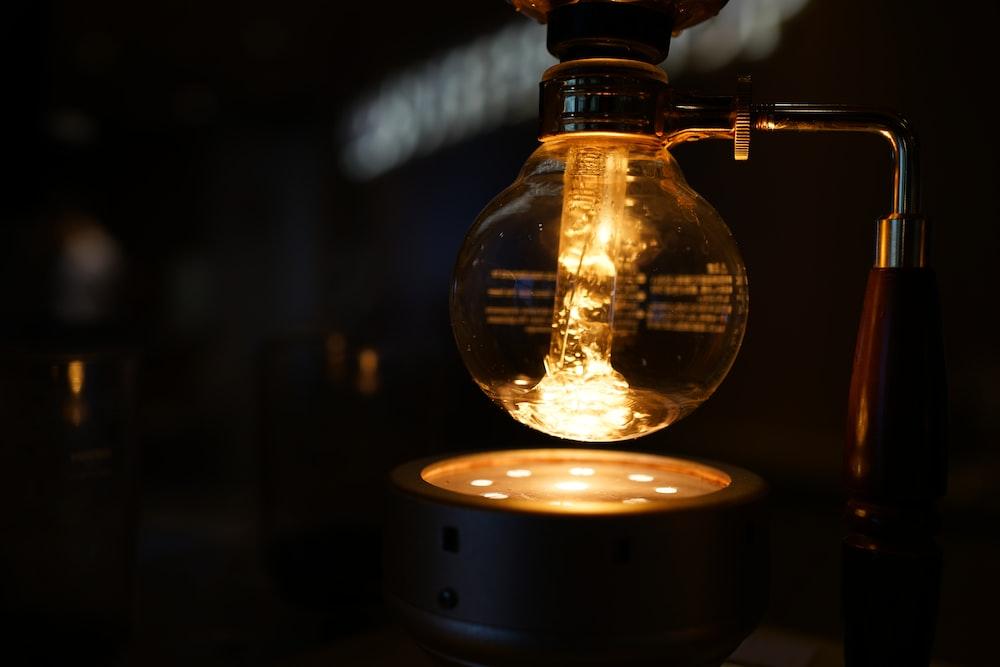 lighted bulb above turned-on flashlight
