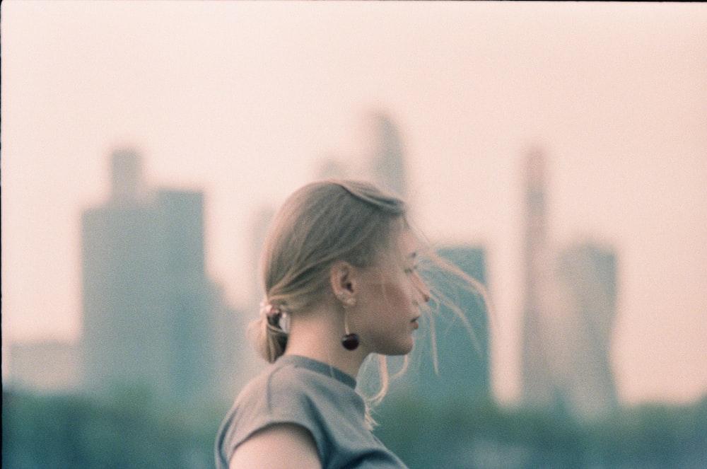 woman wearing gray sleeveless top during daytime