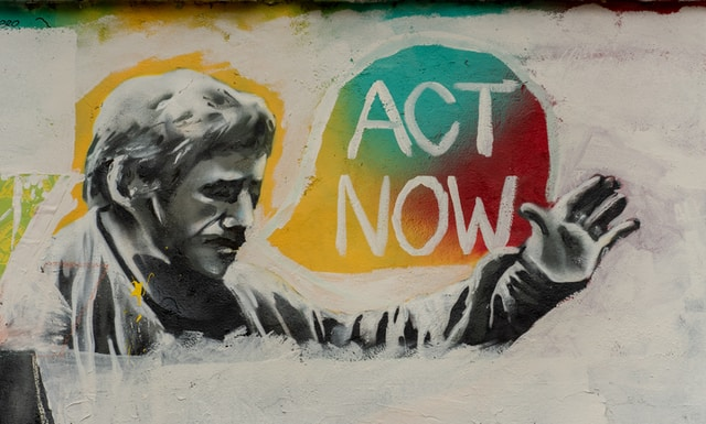 man saying act now painting