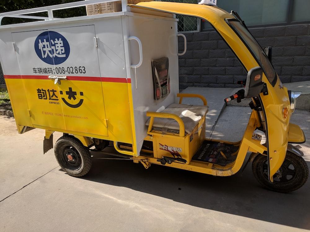 yellow auto rickshaw