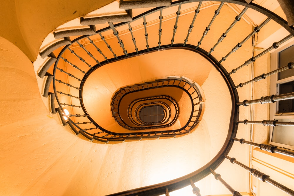 high-angle photography of curved stairs