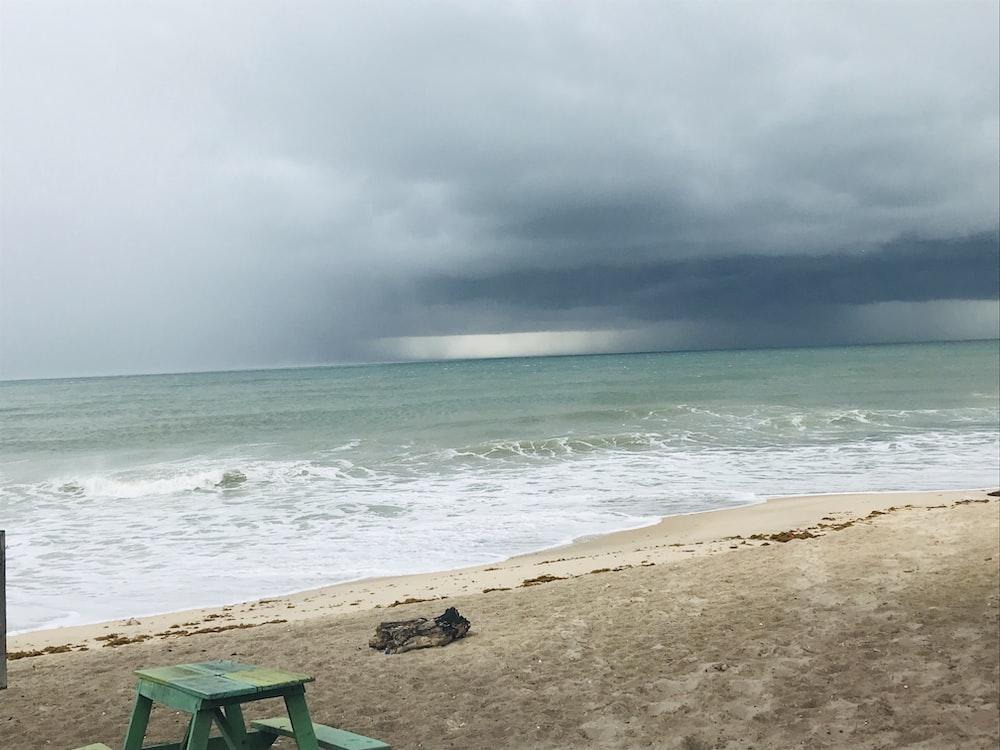 rain clouds over sea