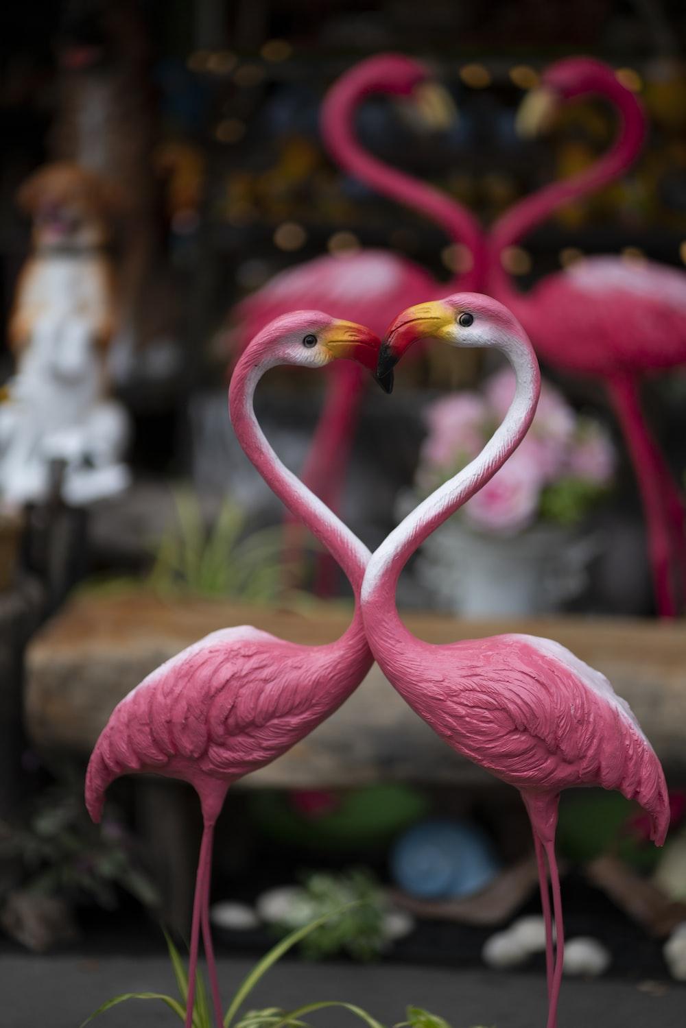 two pink flamingo ceramic figurines