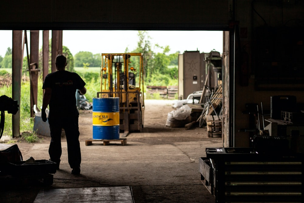 silhouette of person near forklift