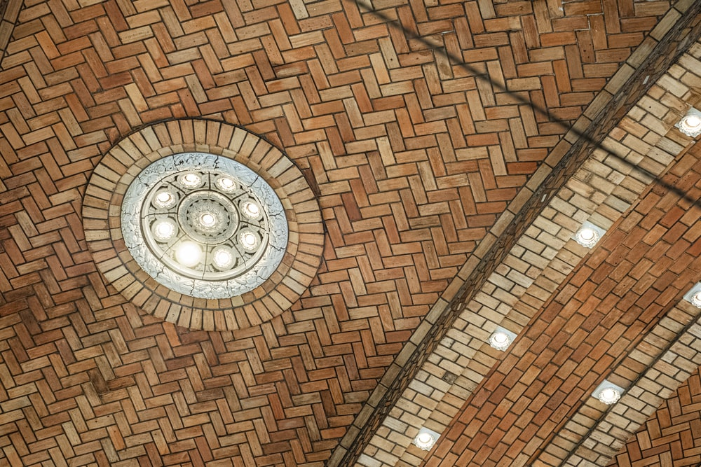 brown tiled building walls and ceiling