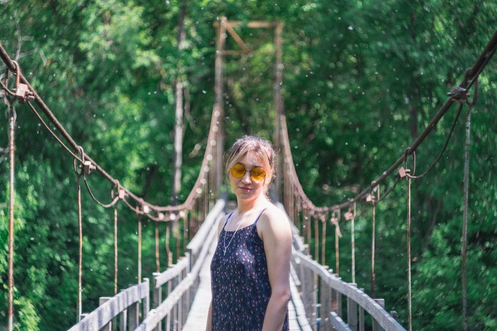 woman standing on hanging bridge