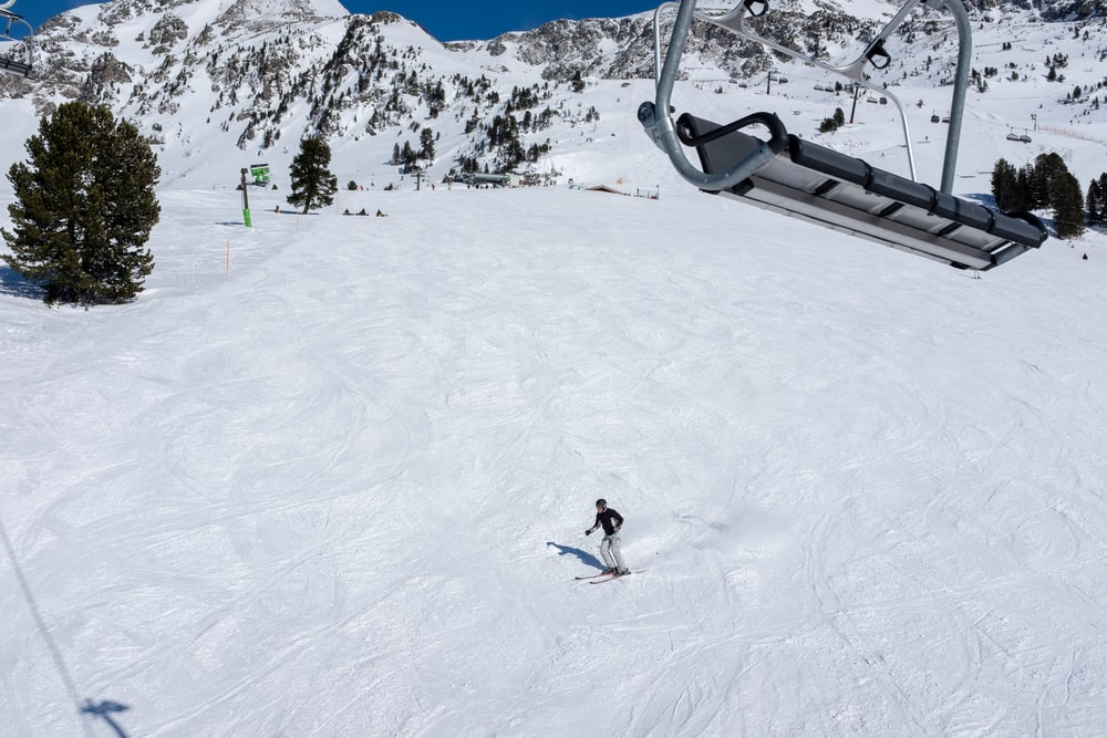 man skiing down the snowy slope