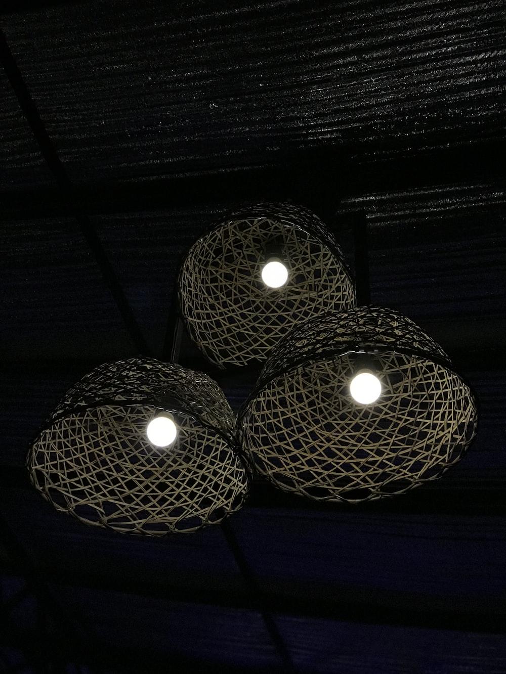 three turned-on gray pendant lamp