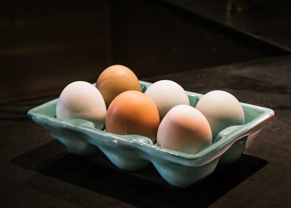 six white and brown eggs