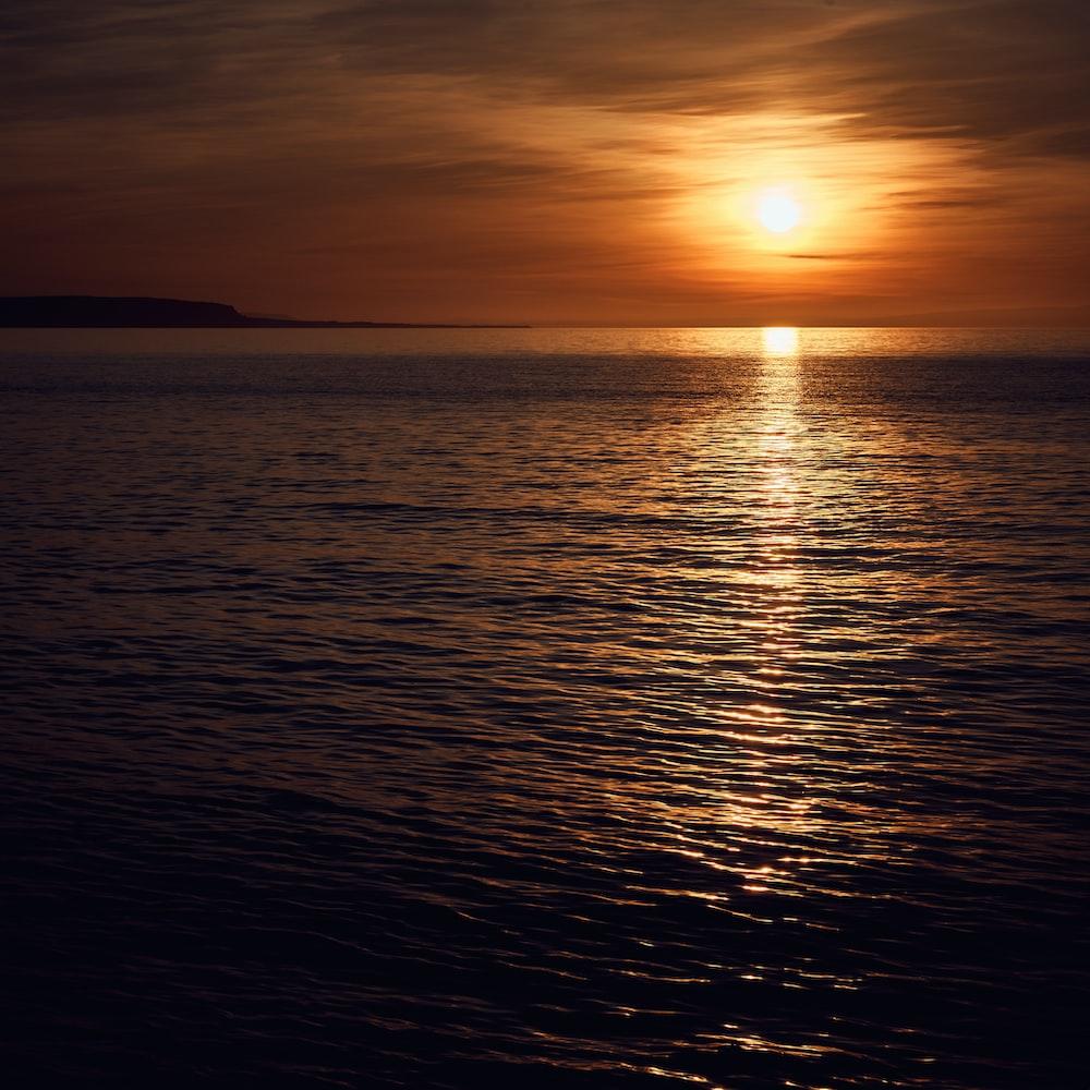 silhouette photo of sea
