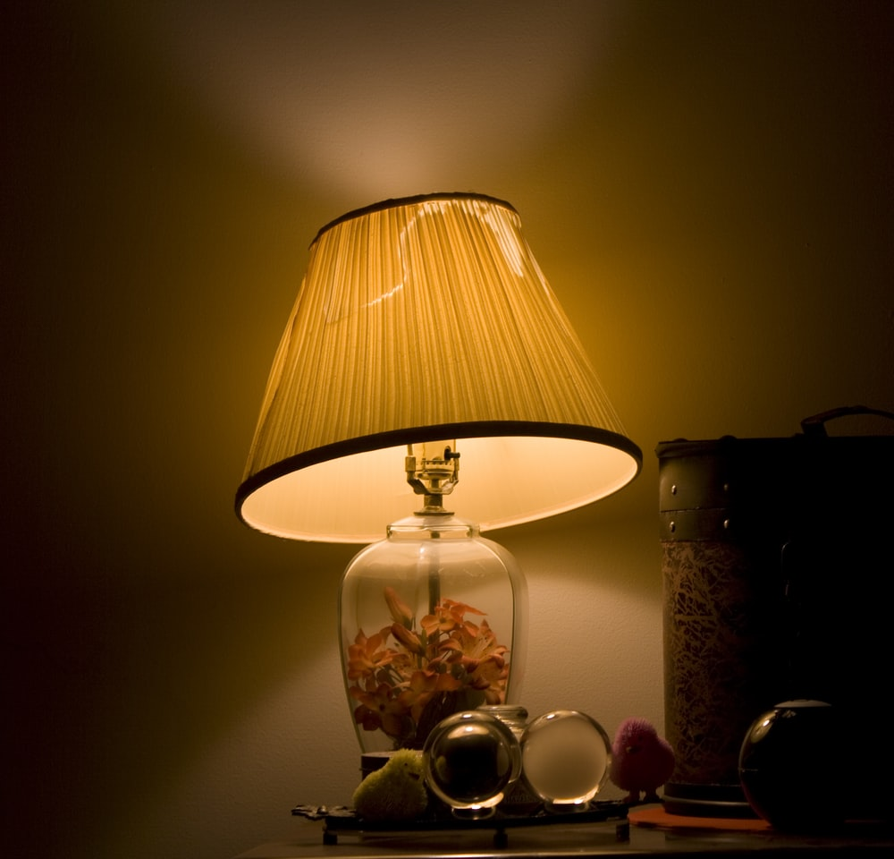 brown and clear glass table lamp