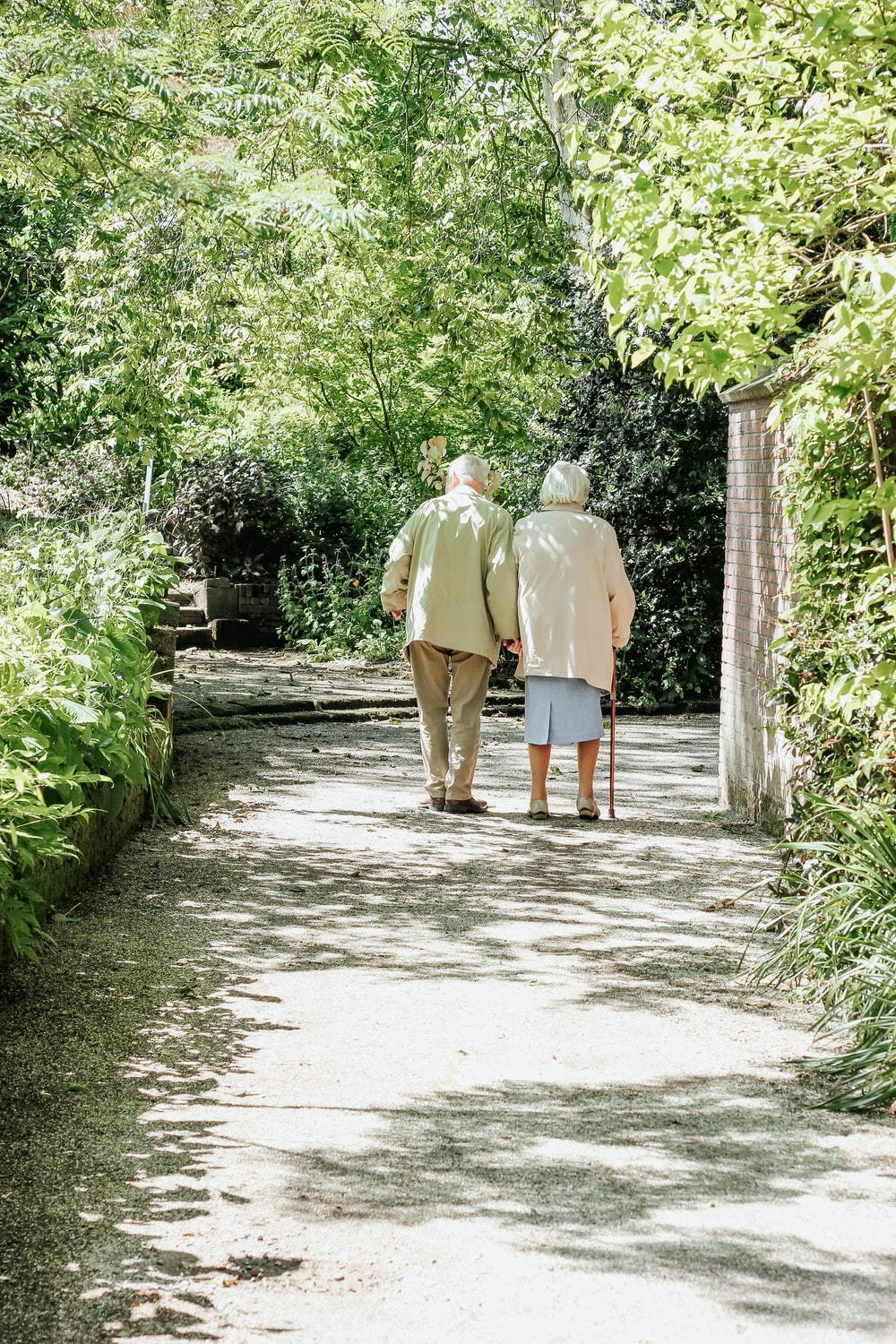 man and woman walking on road during daytime