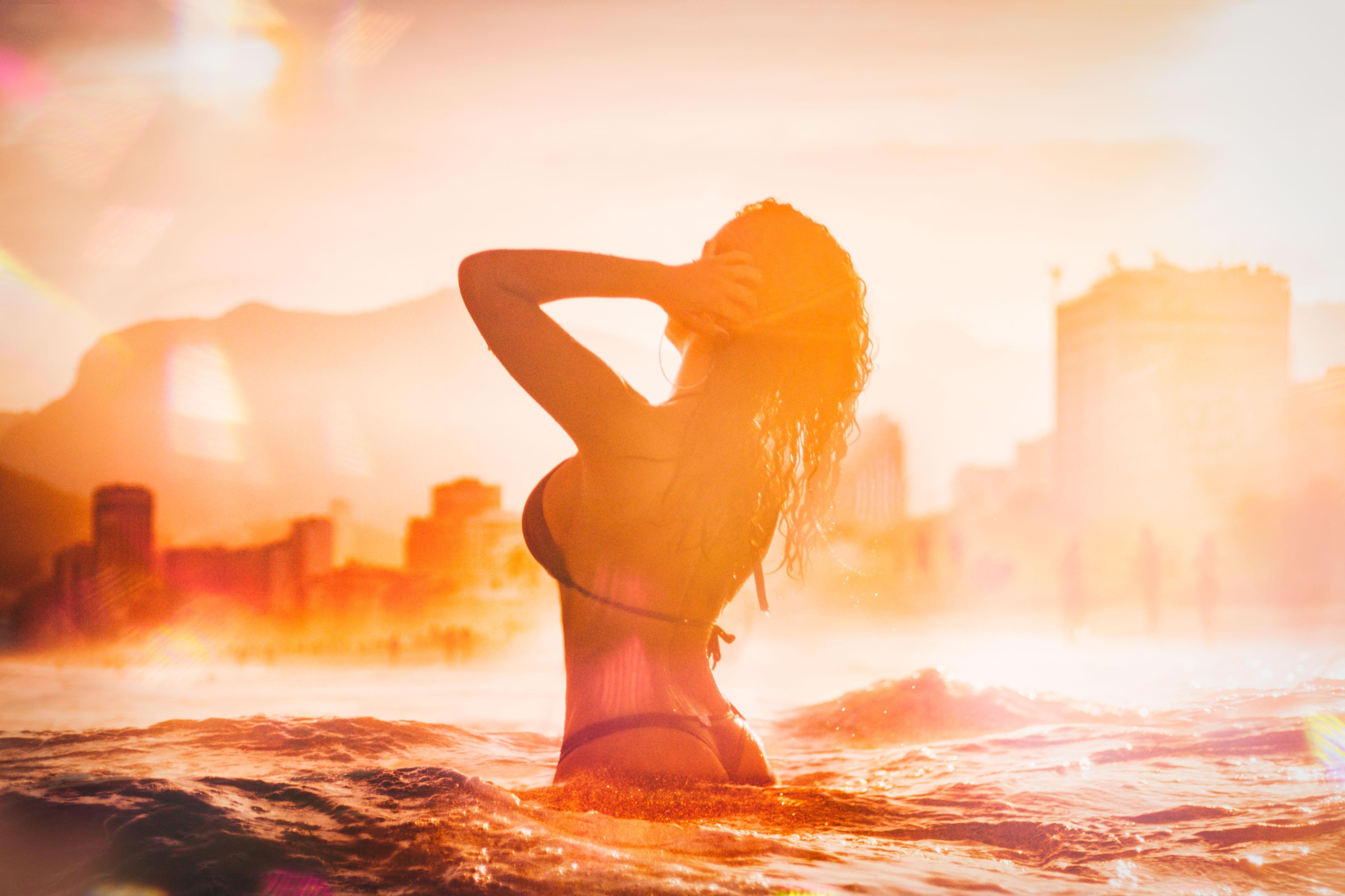 woman in black bikini top