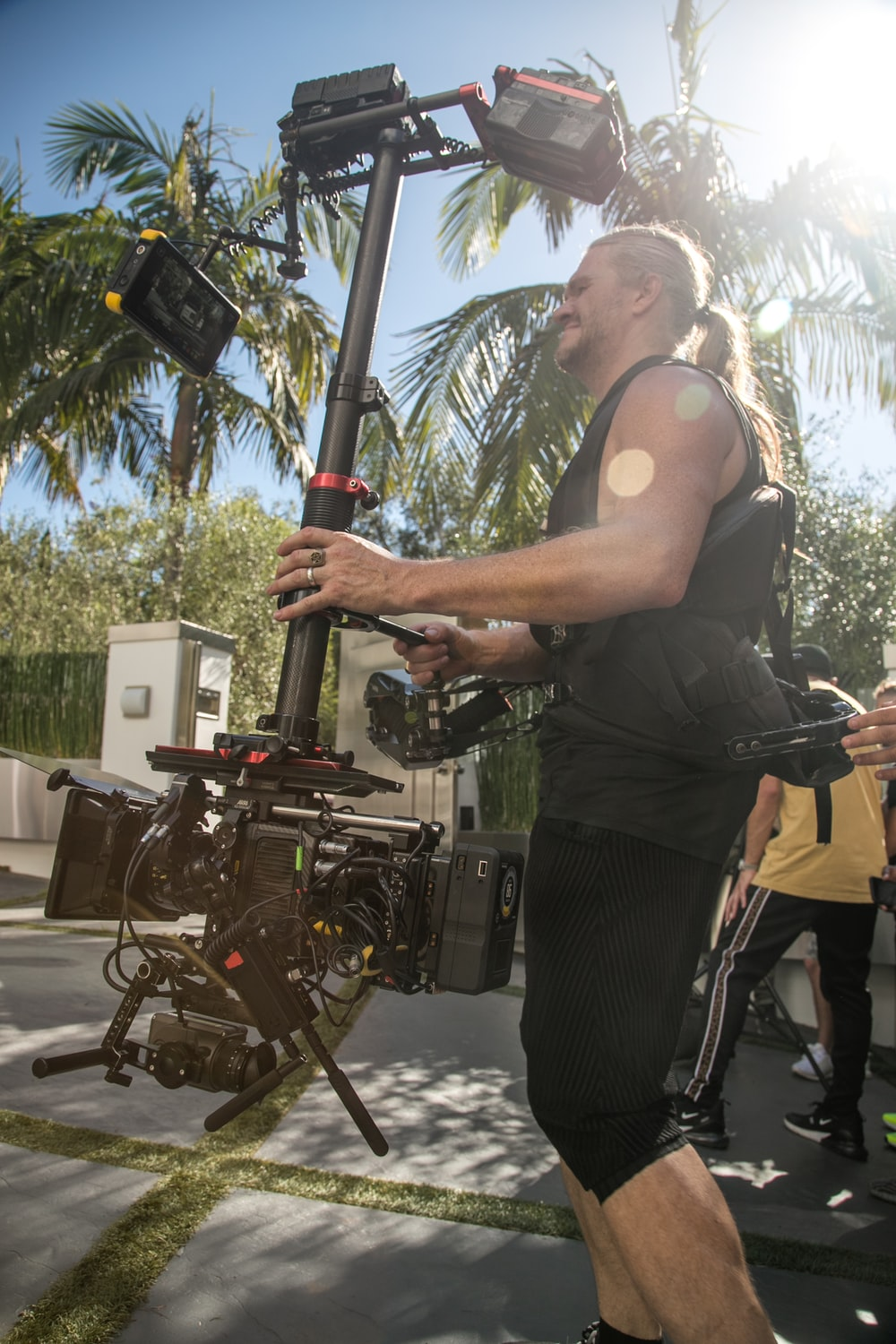 man carrying camera stabilizer