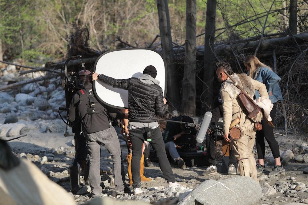 a group of cameramen filming a scene