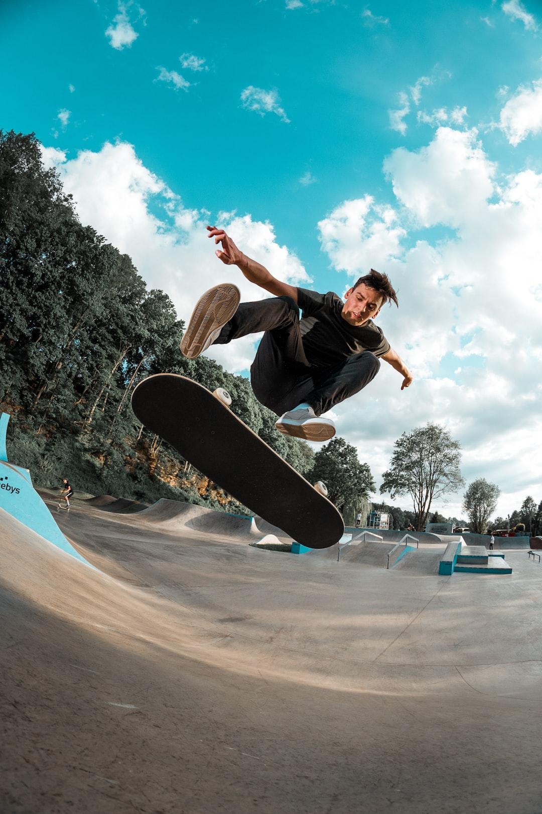 Skateboarder (Karel Hospodka) doing a kick flip