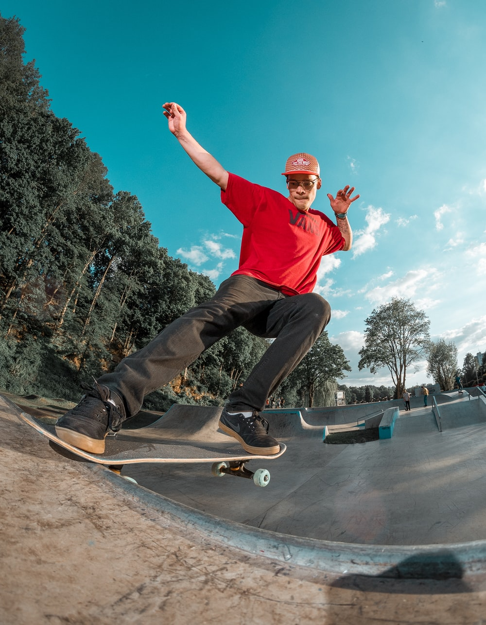 man riding skateboard on skate park during daytime