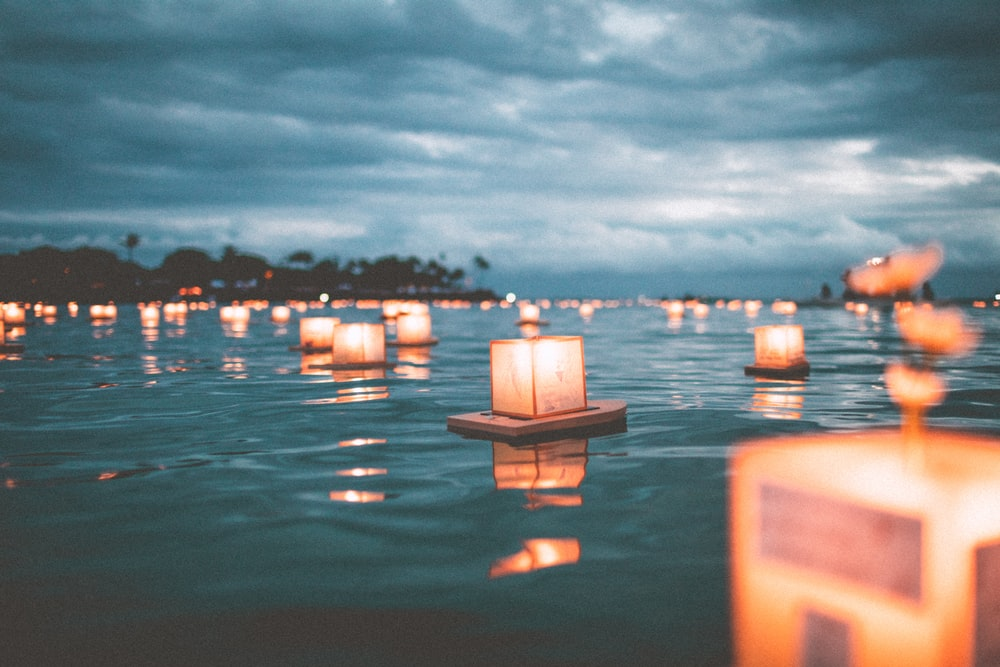 floating candles on body of water