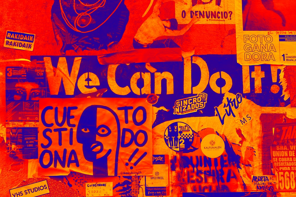 orange and blue We Can Do It poster
