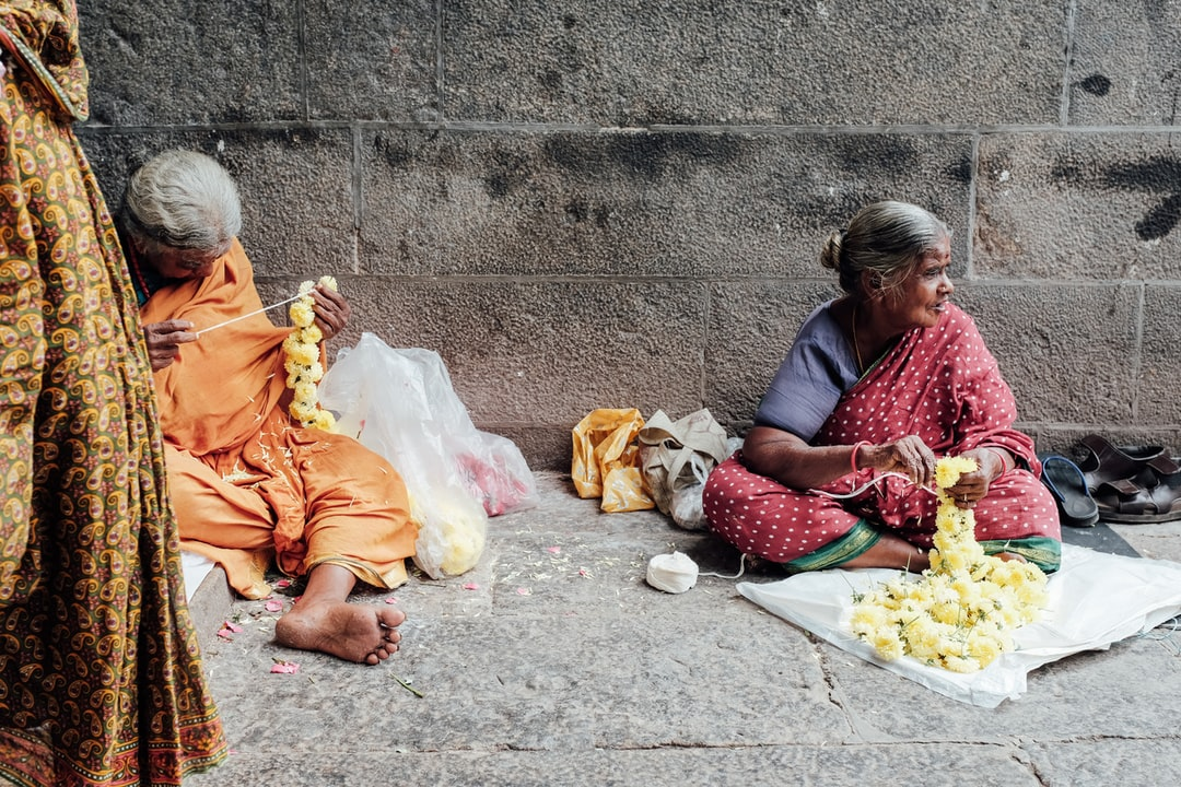 Women selling flowers outside of a Chennai temple.