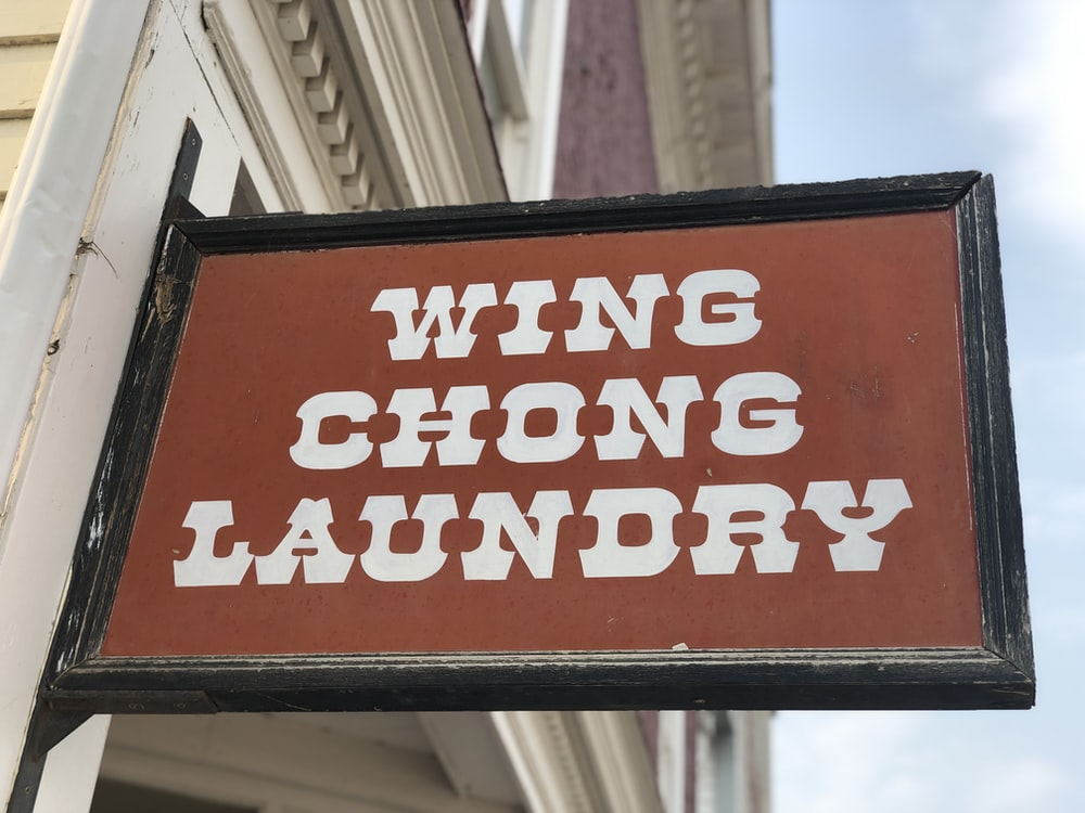 brown and black wing chong laundry signage